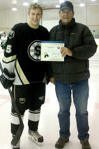 Jarrett Belliveau accepts his Friends of Alberta Junior Hockey Scholarship