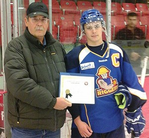 Scott Hanson accepts his Friends of Alberta Junior Hockey Scholarship