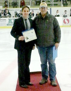 Dylan Hollman accepts his Friends of Alberta Junior Hockey Scholarship