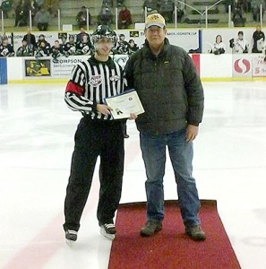 Chris Rebus accepts his scholarship for on ice officials awarded by the Friends of Alberta Junior Hockey Society
