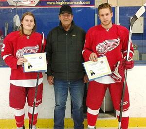 Picture of Spenser Sydor and Talyor Lashyn accepting their scholarships awarded by the Friends of Alberta Junior Hockey Society