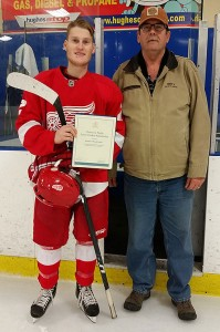 Specer Sydor receives his scholarship from Friends of AJH Society Executive Bill Roberts