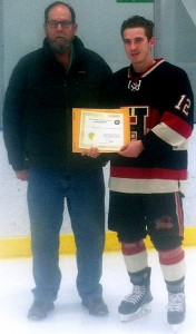 Bill Roberts of the Friends of Alberta Junior Hockey Society presents Gage Gorda with his 2016 Scholarship.