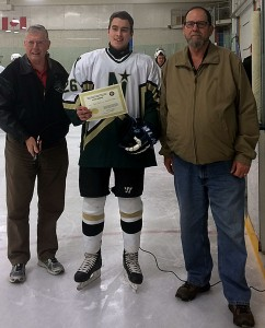 Bob Green and Bill Roberts from the Friends of Alberta Junior Hockey Society present Tyler Weiss from the Edmonton Northstars with the 2016 Richard Warwick Memorial Scholarship