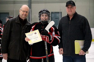 Left to Right: Steve Bluett (Friends of Alberta Junior Hockey Society), Angela Mason (Fort Saskatchewan Fury - Winner of the Charles S. Noble Mark Goodkey Memorial Scholarship), Jeff Fischer (coach of the Fort Saskatchewan Fury Female Junior A hockey Club)