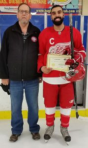Bill Roberts from the Friends of Alberta Junior Hockey Society and Arjun Lotey of the North Edmonton Red Wings