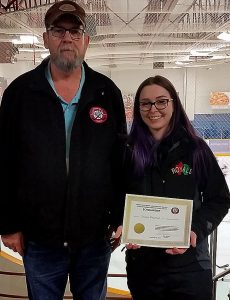 Bill Roberts from the Friends of Alberta Junior Hockey and Jennifer Onyschuk from the Edmonton Royals