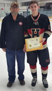 Bill Roberts from the Friends of Alberta Junior Hockey Society and Tyson Davey from the Fort Saskatchewan Hawks