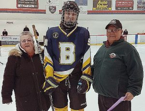 Aaron Schmidtke of the Calgary Jr. C. Blackfoot Chiefs is presented with a Friends of Alberta Junior Hockey Society scholarship by Cathy Hosowich (left) from Hockey Calgary Jr. Council  and Don Allan (right) from the Friends of Alberta Junior Hockey Society