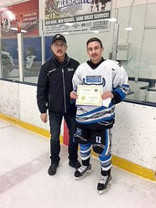 Glenn Ball of the Friends of AJH Society presents Bradley Bujold of the Edmonton Mavericks with his Friends of AJH scholarship