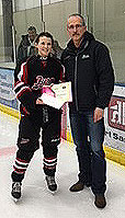 Danae Fischer of the Fort Saskatchewan Fury receives a Friends of Alberta Junior Hockey Society scholarship from Glenn Ball of the Friends AJH Society