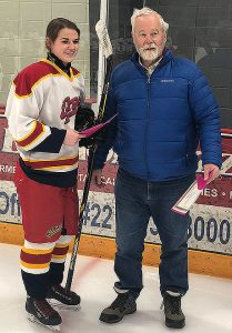 Don Speers from the Friends of Alberta Junior Hockey Society presents Kiera Davidson with her Charles S. Noble Scholarship