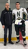 Glenn Ball from the Friends of Alberta Junior Hockey Society presents Edmonton Northstars' Tyler Weiss with his Friends Scholarship