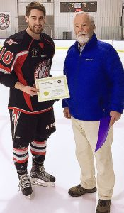 Zachary Giroux of the Airdrie Thunder Junior B Hockey Club is presented with his Friends of Alberta Junior Hockey Society Scholarship by Don Speers of Friends of AJH.