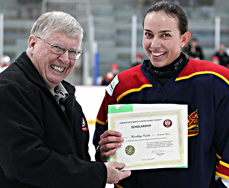Brooklyn Carels of the Cochrane Chaos winner of the Friends of Alberta Junior Hockey Society Scholarship Bob Green presenting