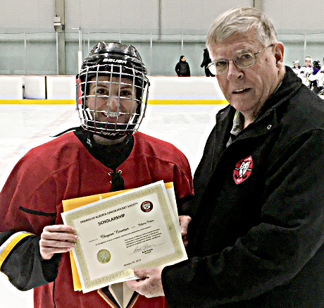 Cheyann Newman of the Calgary Titans receives her Friends of Alberta Junior Hockey Society Scholarship from the Friends Bob Green.