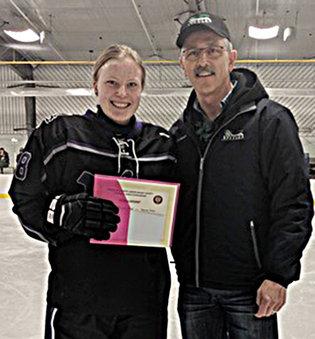 Devyn Reid of the Edmonton Wolves receiving a Charles S. Noble scholarship with Glenn Ball of the Friends presenting