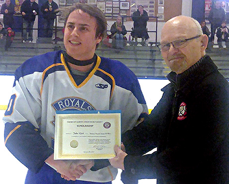 John Geib of the Calgary Royals Jr. B Blue winner of a Friends of Alberta Junior Hockey Society Scholarship being presented by Don Holmes of the Friends Society
