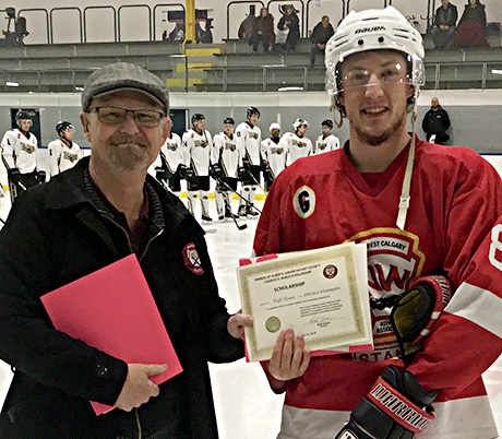 Kyle Exner of the NWCAA Jr. B Stamps winner of the Charles S. Noble Scholarship with Owen Ritchie accepting on his behalf. Presenting is Don Holmes of the Friends Society
