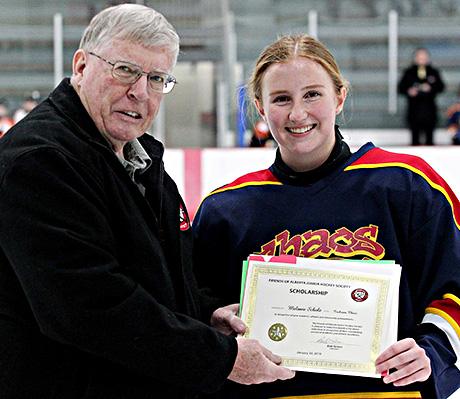 Melanie Scholz of the Cochrane Chaos winner of the Friends of Alberta Junior Hockey Society Scholarship Bob Green presenting