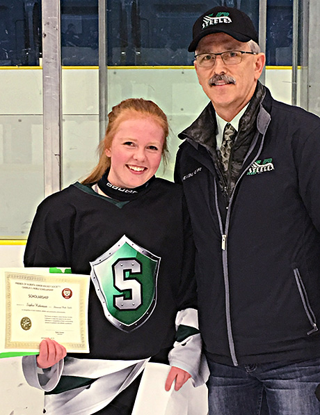 Sophie Robertson  of the Sherwood Park Steele   winner of the Charles S. Noble Scholarship   Glenn Ball of the Friends of AJH  presenting