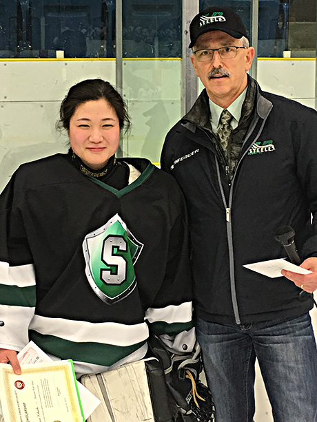 Tracie Kikuchie  of the Sherwood Park Steel   winner of the Friends of Alberta Junior Hockey Society scholarship   Glenn Ball presenting