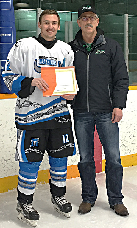 Bradley Bujold of the Edmonton Mavericks  is presented a Friends of Alberta Junior Hockey Society scholarship.  Presenting is Glenn Ball of the Friends.