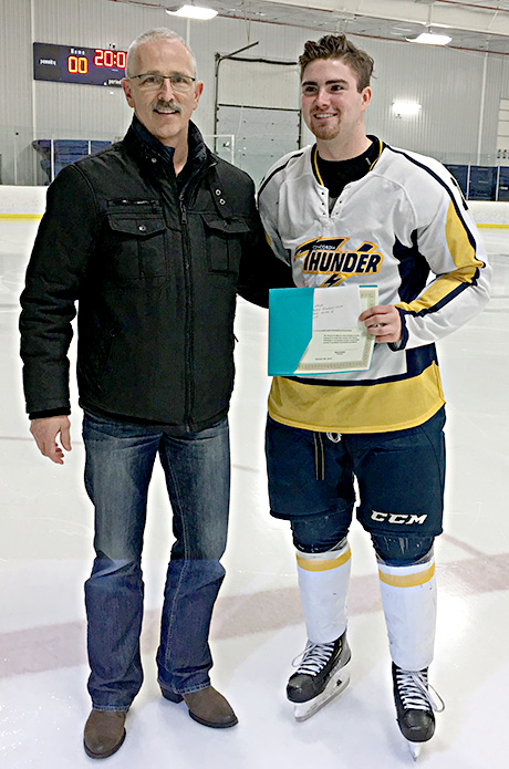 Curtis Peck of the Drayton Valley Thunder is the winner of the Al McDonald Memorial Scholarship from the Friends of Alberta Junior Hockey Society!!! Presenting is Glenn Ball of the Friends Society