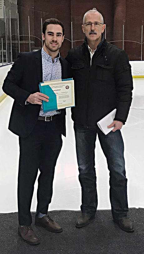 Glenn Ball of the Friends of Alberta Junior Hockey Society presents Ryan Piche  of the Bonnyville Pontiacs with his Charles S. Noble scholarship.
